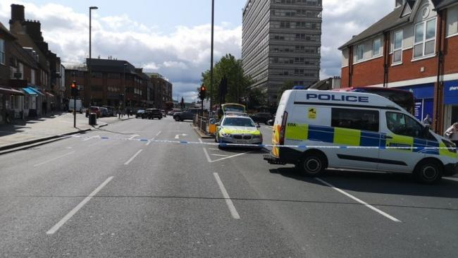 Roads are closed after a woman was hit by a lorry. Credit: Met Police