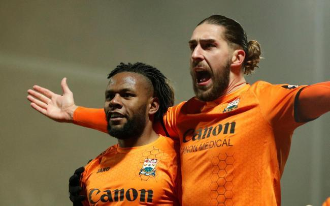Shaquile Coulthirst and Dan Sweeney celebrate Barnet's second goal against Brentford in last season's FA Cup fourth round. Picture: Action Images