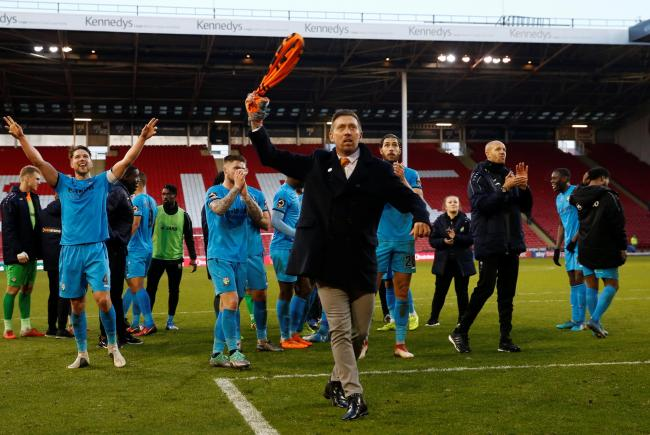 Darren Currie leading Barnet's celebrations at Sheffield United last season. Picture: Action Images