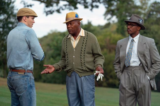 Nicholas Hoult, Samuel L. Jackson and Anthony Mackie in a scene from The Banker