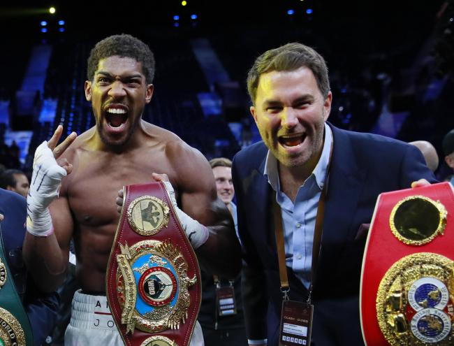 Eddie Hearn joins Anthony Joshua in celebrating his victory over Andy Ruiz Jr in December. Picture: Action Images