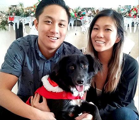 First author Tina Wang, PhD, (right) with her husband, Brandon, and their dog, Belli, who inspired the study. Photo: SWNS