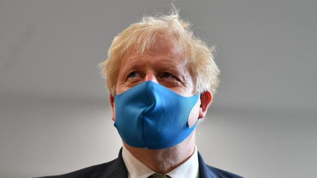 Boris Johnson has urged the public to wear face coverings in shops. Photo: PA