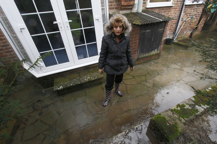 Cynthia Samson on her patio which has been flooded for a year