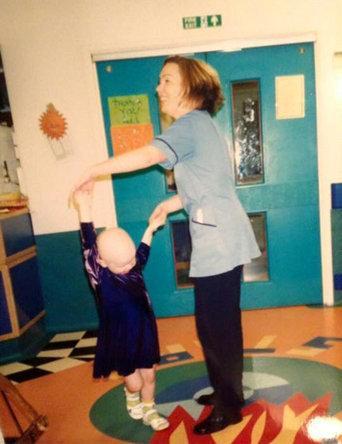 Times Series: Nurse Kate Pye dancing with Clara at the Royal London Hospital. Credit: SWNS