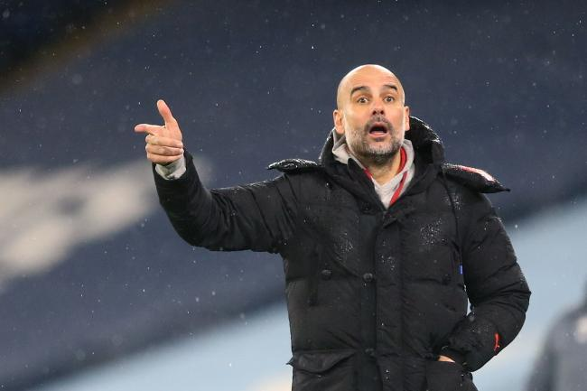 Manchester City manager Pep Guardiola is dismissive of their quadruple chances. (Martin Rickett/PA)