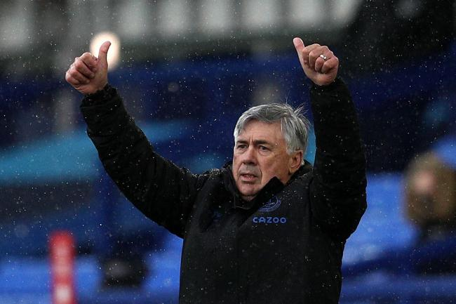 Everton manager Carlo Ancelotti sticks both thumbs in the air