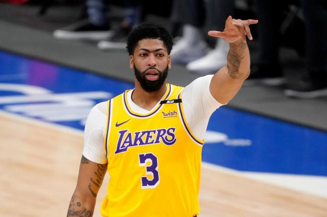 Anthony Davis gestures in front of his body with his left arm outstretched