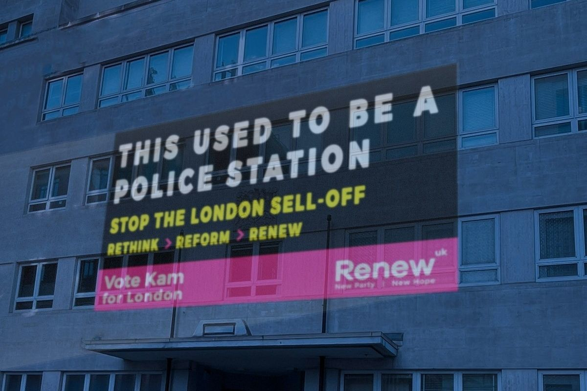 A Renew Party campaign image is projected onto a former police station in Westminster. Credit: Renew Party handout