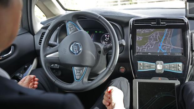 Times Series: Self-driving cars enabling drivers to take their eyes off the road and their hands off the wheel could be permitted on UK motorways later this year (Philip Toscano/PA)