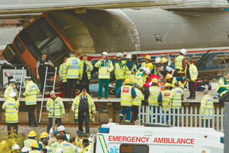 Aftermath: emergency crews at the scene of the Potters Bar rail disaster in 2002
