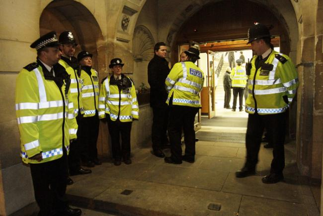 Police and extra security guards were drafted in for last night's meeting