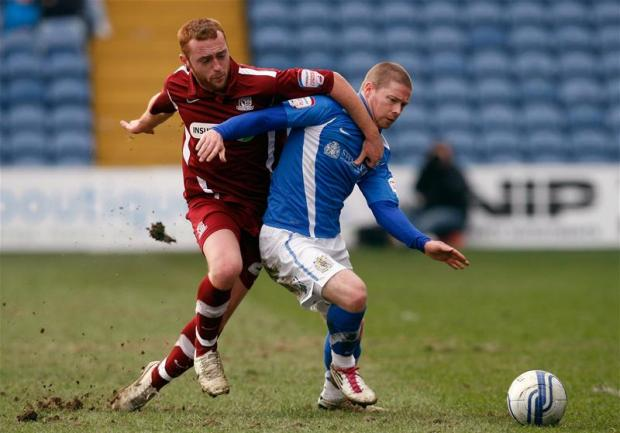 Crawford, left, in action for Southend United. Picture: Action Images