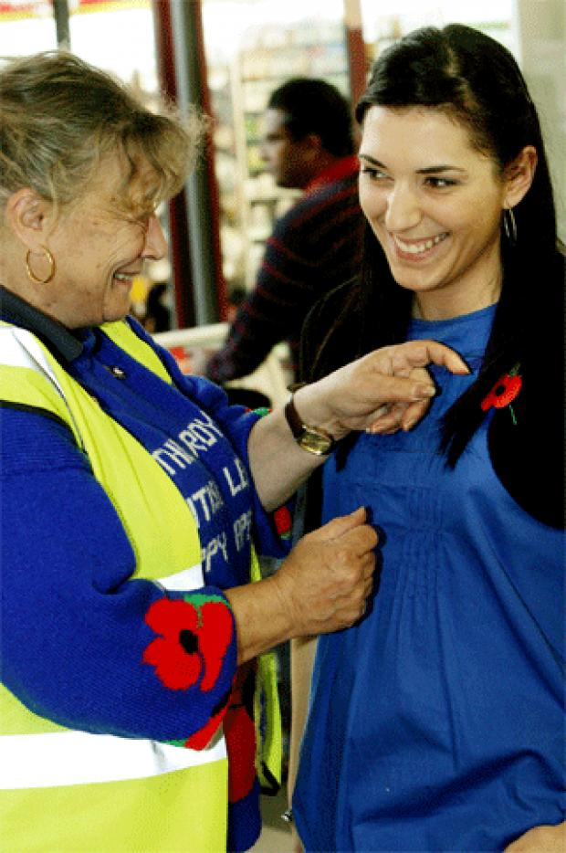 A New Edgware RBL member hands out poppies during last year's appeal