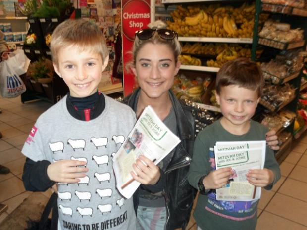 Jacob and Jonah Stanton receive a donation from former X Factor contestant Katie Waissel at Tesco, Hampstead.