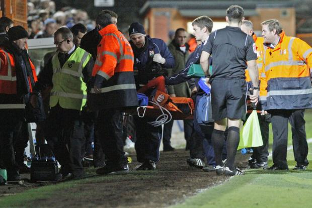 Senda left the pitch against Swindon Town on a stretcher after dislocating his knee cap