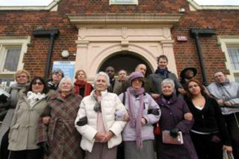 Times Series: Members of Save Friern Barnet Library campaign group outside Friern Barnet Library