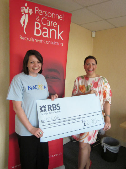 Personnel & Care Bank hands over cash to The National Association for Children of Alcoholics