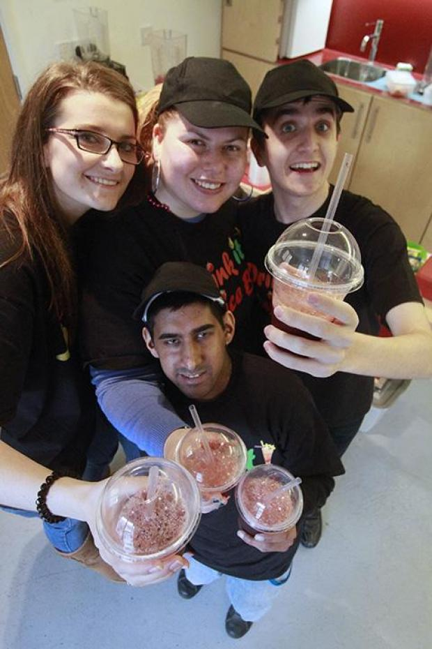 Barnet Mencap's Laura Davitt with staff at Drink It Juice Bar