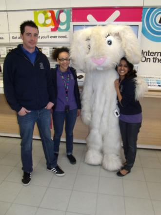 Staff from the Three store with the Easter Bunny