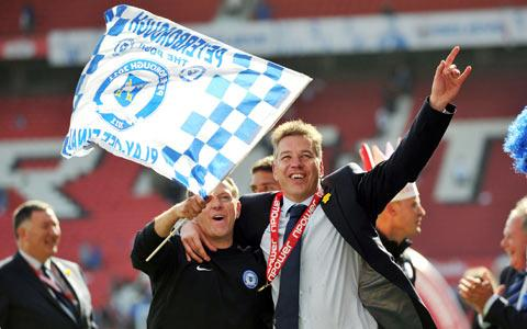 Mark Robson, left, celebrates Peterborough's play-off success of two seasons ago with Darren Ferguson. Picture: Action Images