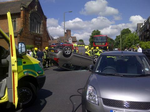 This was the scene when a car collided with two parked vehicles and flipped onto its roof in Hendon