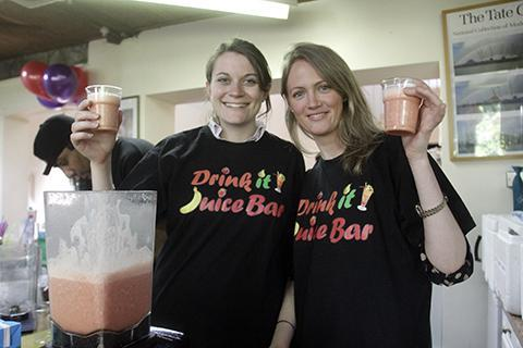 Reporters Emma Innes and Natalie O'Neill help out at the juice bar