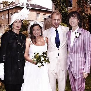Jade Jagger at her wedding to Adrian Fillary, with her parents Bianca Jagger, left, and Sir Mick Jagger, right (Robert Astley-Sparke/LD Communications/PA Wire)