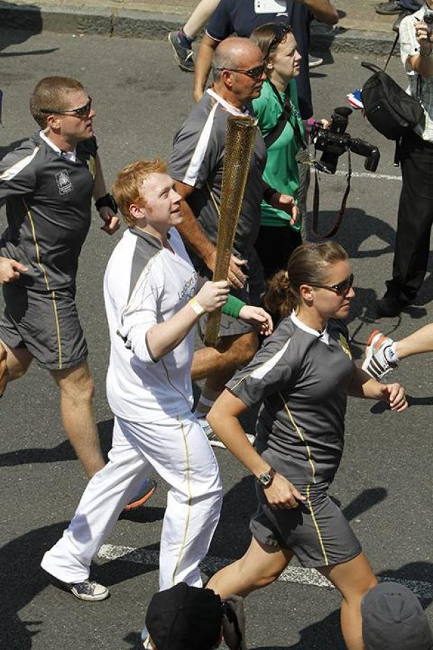 Harry Potter star Rupert Grint and dozens of torchbearers carried the Olympic Flame on its journey through the borough