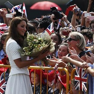 The Duchess of Cambridge receives flowers from fans at Gardens by the Bay in Singapore (AP/Edgar Su)