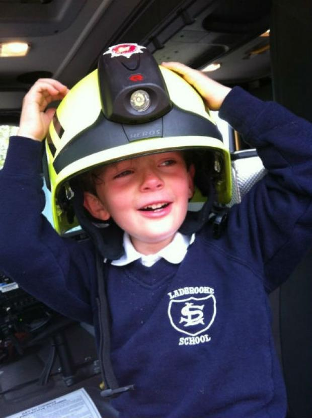 Little Oliver was allowed to sit in the fire engine to cheer up after the mishap