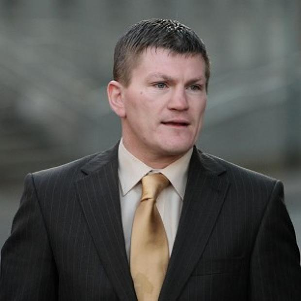 The father of ex-boxing champion Ricky Hatton has been arrested for attacking his son, police sources say
