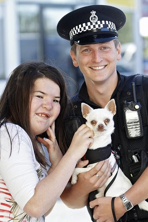 PC Paybody and Clarice Stokes, who was 'over the moon' at being reunited with Rocky