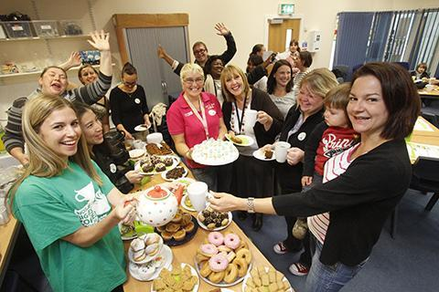 Parents and staff enjoy cake and coffee in aid of Macmillan Cancer Support