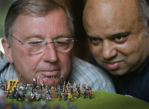 Historians at Barnet Museum look over a model re-enactment of the battle when the project was commissioned in 2012