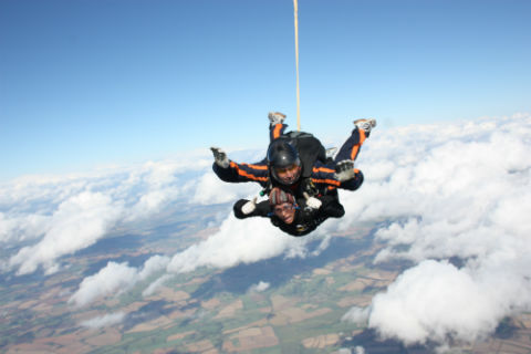 Oruj Defoite jumps out of plane with instructor, Stuart Meacock.