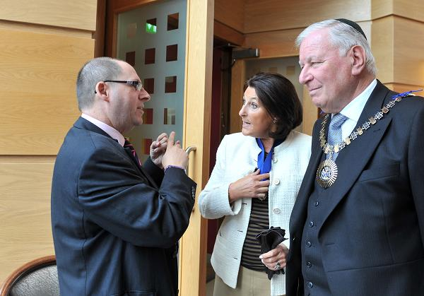 Simon Morris Jewish Care's CEO greets Cllr Brian Schama, Mayor of Barnet, and his wife