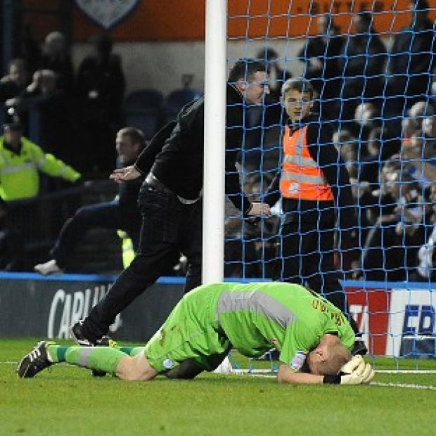 Sheffield Wednesday goalkeeper Chris Kirkland after been struck by a Leeds United fan
