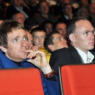 Times Series: Bradley Wiggins, left, and Chris Froome look on during the 2013 Tour de France Presentation in Paris