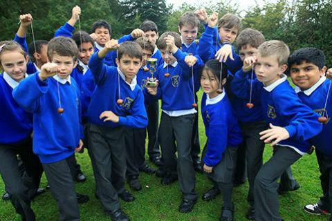 Pupils at Woodridge Primary School took part in lunchtime conker tournament set up by their headteacher