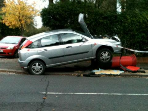 A car sent letters sprawling when it smashed into a post box. Pic by Barry Weitz.