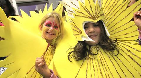 Children donned carnival outfits including sparkly sunshine suits