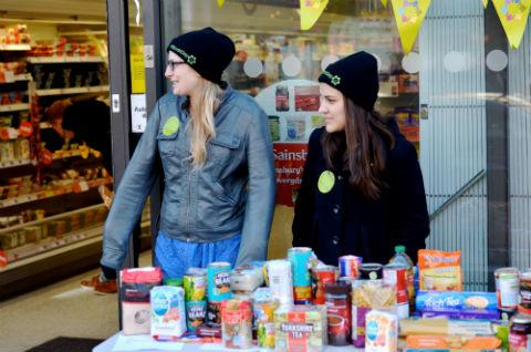 Mitzvah Day volunteers Rebecca Gore and Esther Gonzalez outside Sainsbury's, Golders Green.