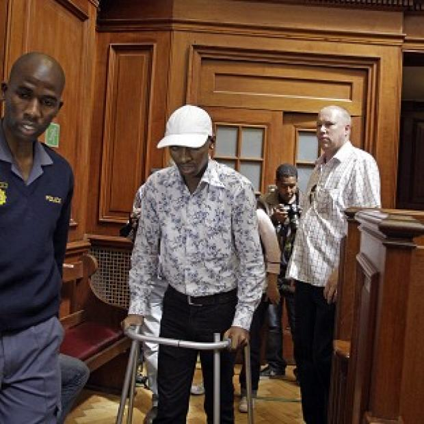 Xolile Mngeni walks into court, where he was convicted of shooting honeymoon tourist Anni Dewani in 2010 (AP)