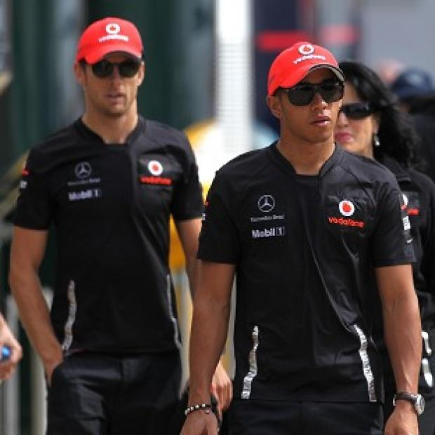 Lewis Hamilton, right, is on pole for the Brazilian GP with team-mate Jenson Button alongside him