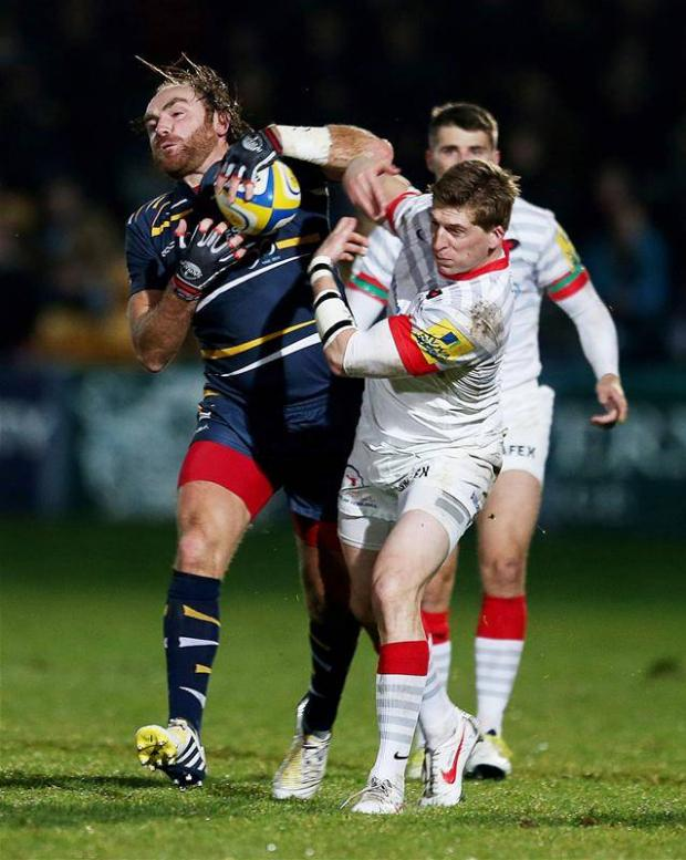 David Strettle battles with Andy Goode for the ball