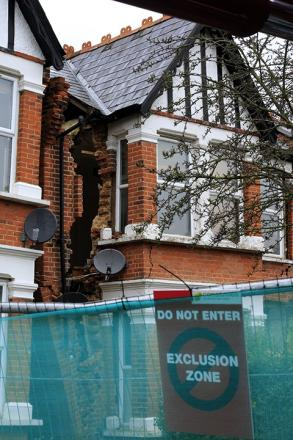 Builders had been digging out a basement at the property before it caved in