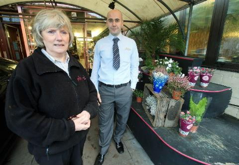 Florist Pauline Martin and restaurant manager Lorenzo Crosta next to the flower stall on which the woman gave birth
