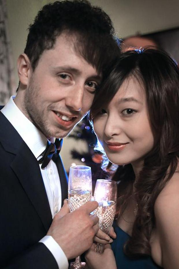 Joeh Chan and Ginny Chan toast to their happiness