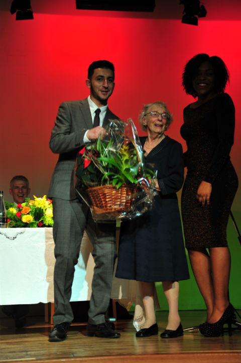 Head boy, Ahmed Kerwan and head girl, Vanessa Assombalonga presenting a gift of thanks to Mrs Franks